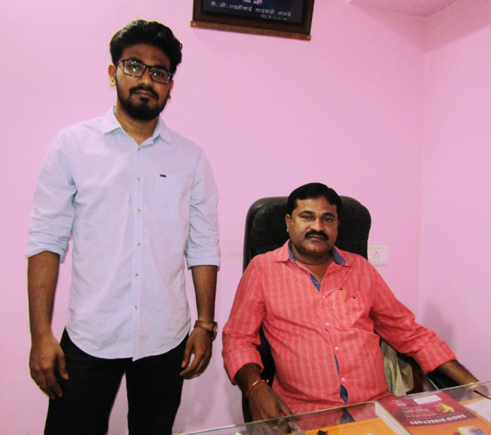 Sudam Nagare, proprietor of Vidhi Labels (sitting) with his son Amit Nagare