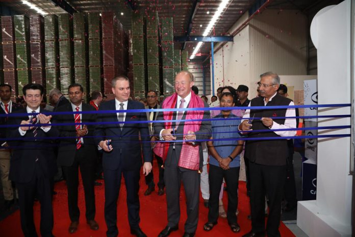 Mr. Peter Giorgi, Owner and Chairman of the Supervisory Board of CANPACK, Mr. Herman Nicolaas Nusmeier, CEO & President of the Managing Board of CANPACK, Mr. Adam Burakowski - Ambassador of the Republic of Poland in New Delhi, India and Mr. Devender Singh - Principal Secretary of Industries, inaugurating new plant
