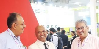 Alan Baretto managing director of Nilpeter India with label converters at the Nilpeter India stand at Labelexpo India 2018