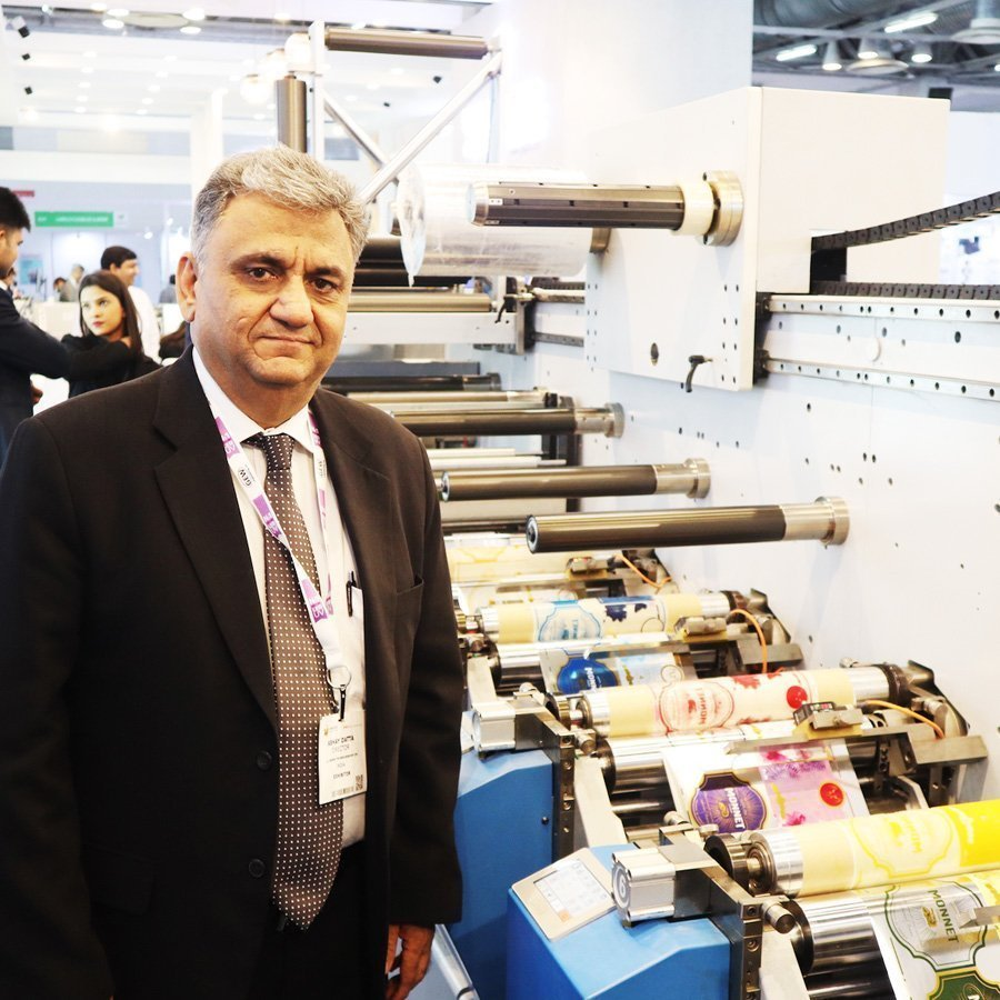 Abhay Dutta managing director of UV Technologies with the newly launched Ultraflex label press at Labelshow India 2018.