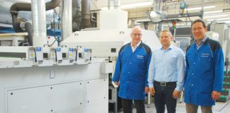Michael Wagner (left), COO and Production Manager Urs Mauerhofer (right) with Mario Werner from IST Metz in front of the final curing stage with four UV units.