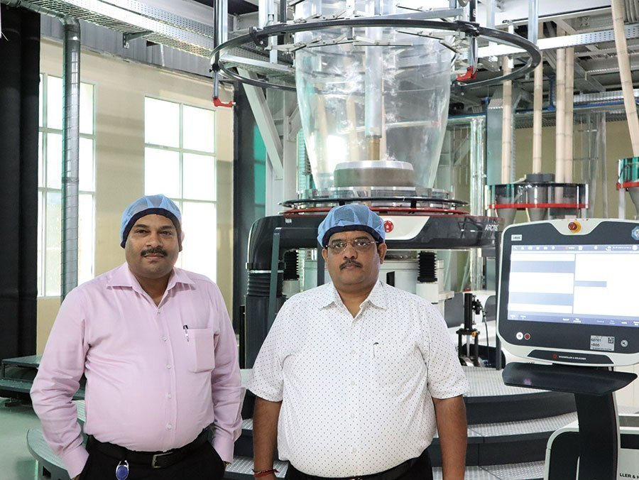 MD Shiv Kumar Gupta and Kaushik Nag with one of the two new Varex film lines provided by W&H. Photo PSA
