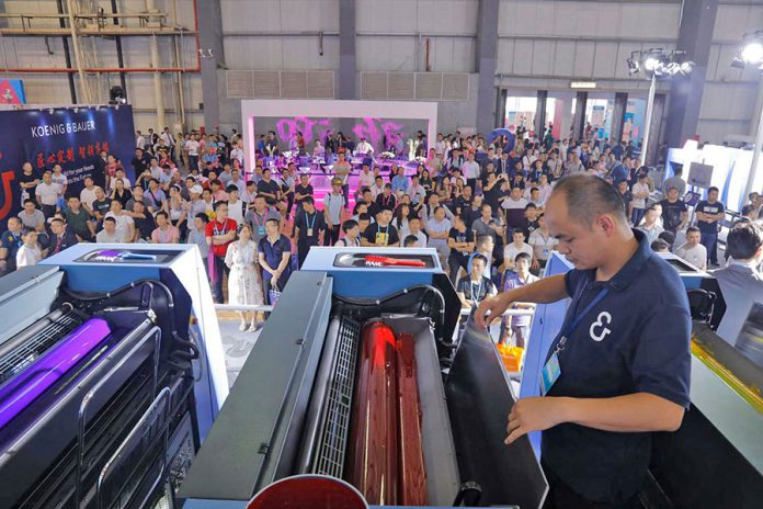Print demonstration on the largest sheetfed offset press on the Koenig & Bauer stand, an eight-colour Rapida 106 with coater and extended delivery