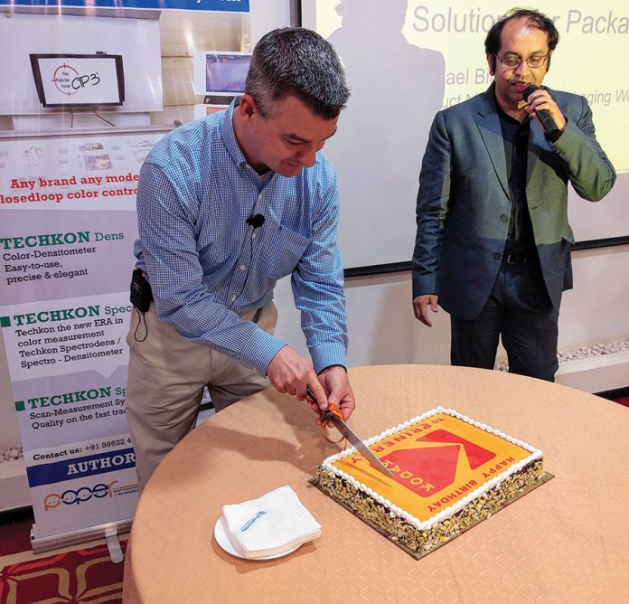 Michael Bialko of Kodak cutting the cake. Photo PSA