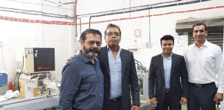 L-R: Vikram Vadchhedia, Sunil Bhargava and Pranay Bhargava of Trimpack with Suraj Sharma of Bobst alongside the Ambition folder-gluer