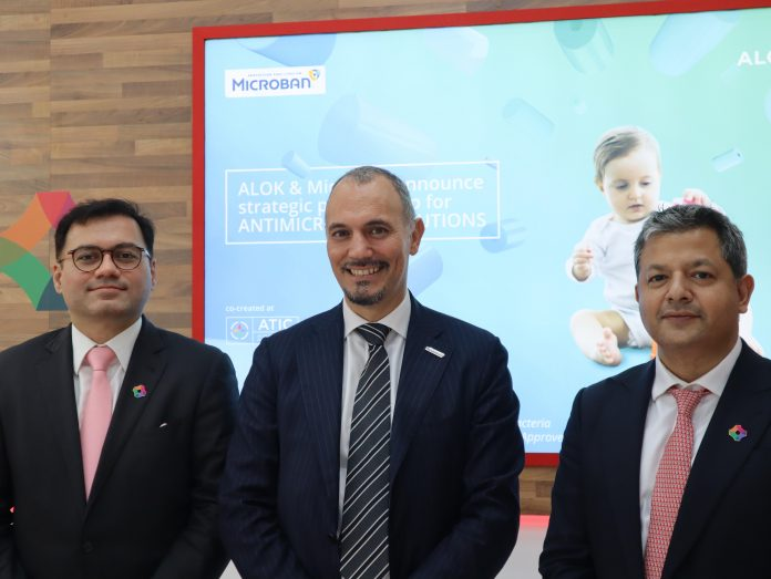 Amit Puri, director of sales and marketing, Alok Masterbatches, with Giorgio Rimini, Microban's Managing Director for the EMEA territories, and Vikram Bhadauria, director of Alok Masterbatches announcing their partnership at K 2019 at the Alok Masterbatch stand in Hall 8A. Photo PSA