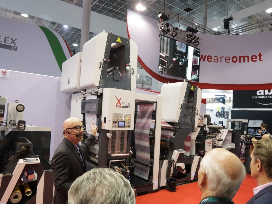 Omet X7, narrow web label press with the water-based rotogravure unit displayed at the Omet Stand at Labelexpo Europe 2019 in Brussels. Photo PSA