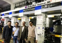 L-R: Kartik Rai, Domestic & International Marketing Manager, Engineering Business, Md. Lutfor Rahman, marketing manager of Kalyar Packaging, Mohammad Yasin, general manager of Kalyar Packaging and Sanjay Sabharwal, executive vice president, Engineering Business, Uflex alongside Rotoflex Stanmans 20, 4-color rotogravure printing press especially designed for printing on aluminum foil. Photo PSA