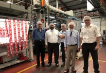 Polytec and Comexi teams in front of the new Comexi F2 ML CI flexo press at Polytec's plant in Guatemala Photo Comexi