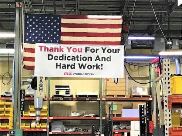Banner thanking Mark Andy's employees was placed in the manufacturing building in Missouri, United States. Photo Mark Andy