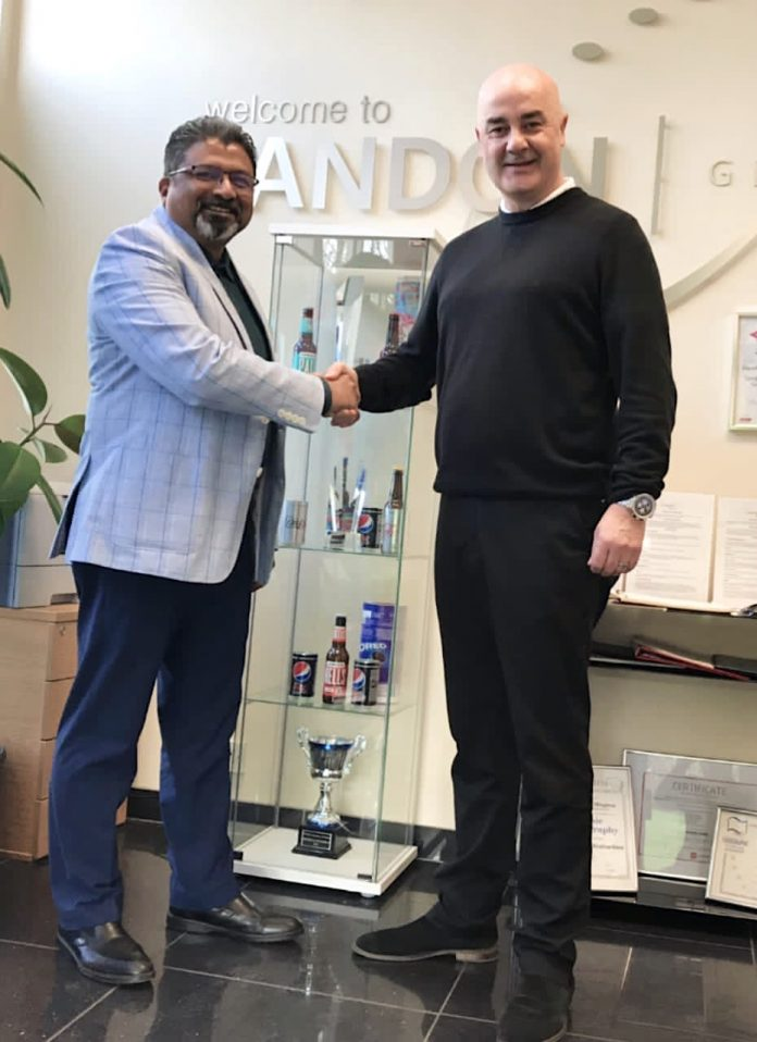 Suhas Kulkarni general manager, Business Development Asia Pacific, Printing Packaging and Converting of DKHS and Stuart Mitchell, Global Sales director, Sandon Global shake hands on their partnership for Asian regions