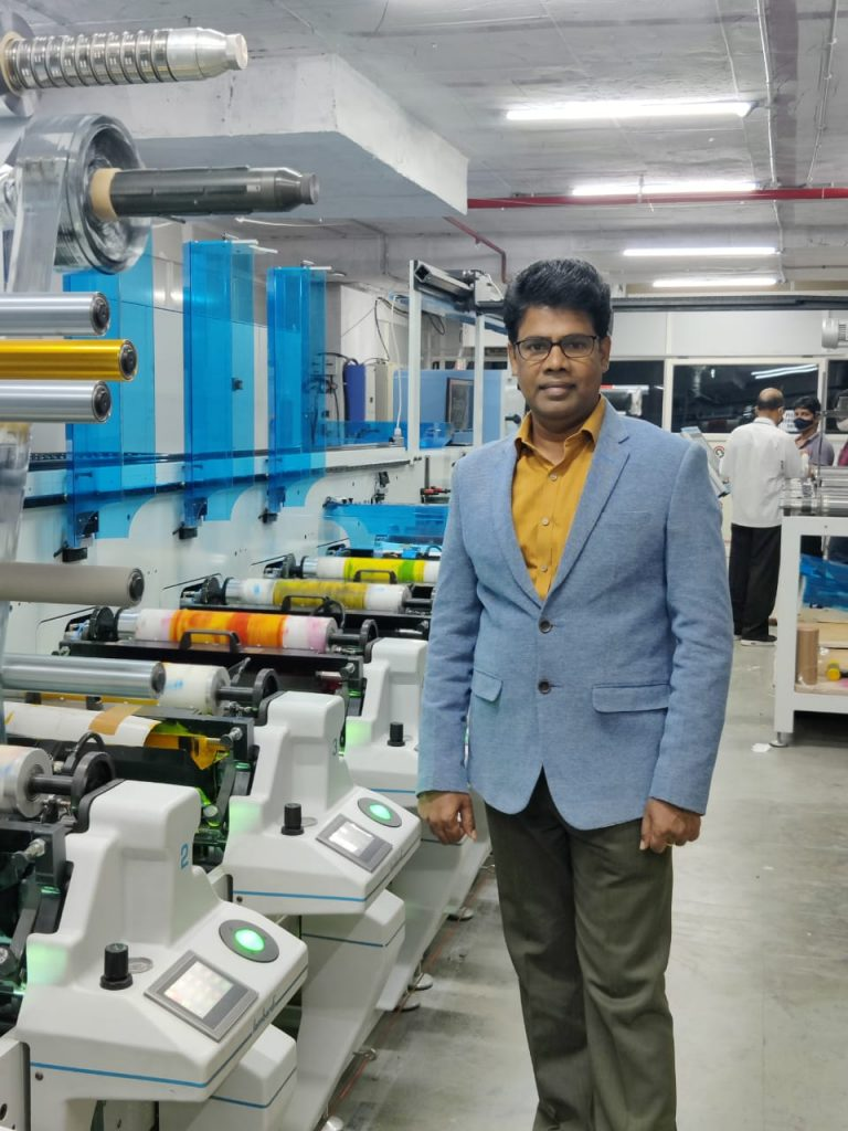 Managing director and CEO Karunakar of Sreeven The Offset Printers with the new Lombardi Synchroline 430 8-color label press sold and installed by Vinsak