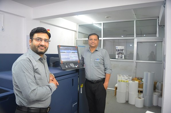 Dheeraj Sharma, managing director of M.D Graphics (on the left) with the AccurioLabel 230