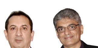 Sanjay Shah of chairman and managing director of Manugraph on left and Shailesh Bhoolabhai, chairman and managing director of Raulimex on right Photo Multigraph